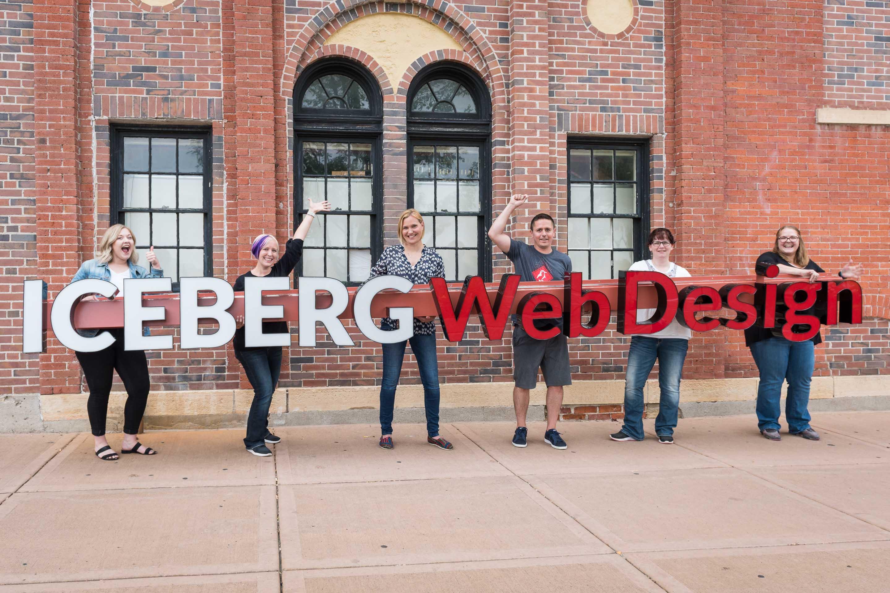 Iceberg Team Holding the Iceberg Logo