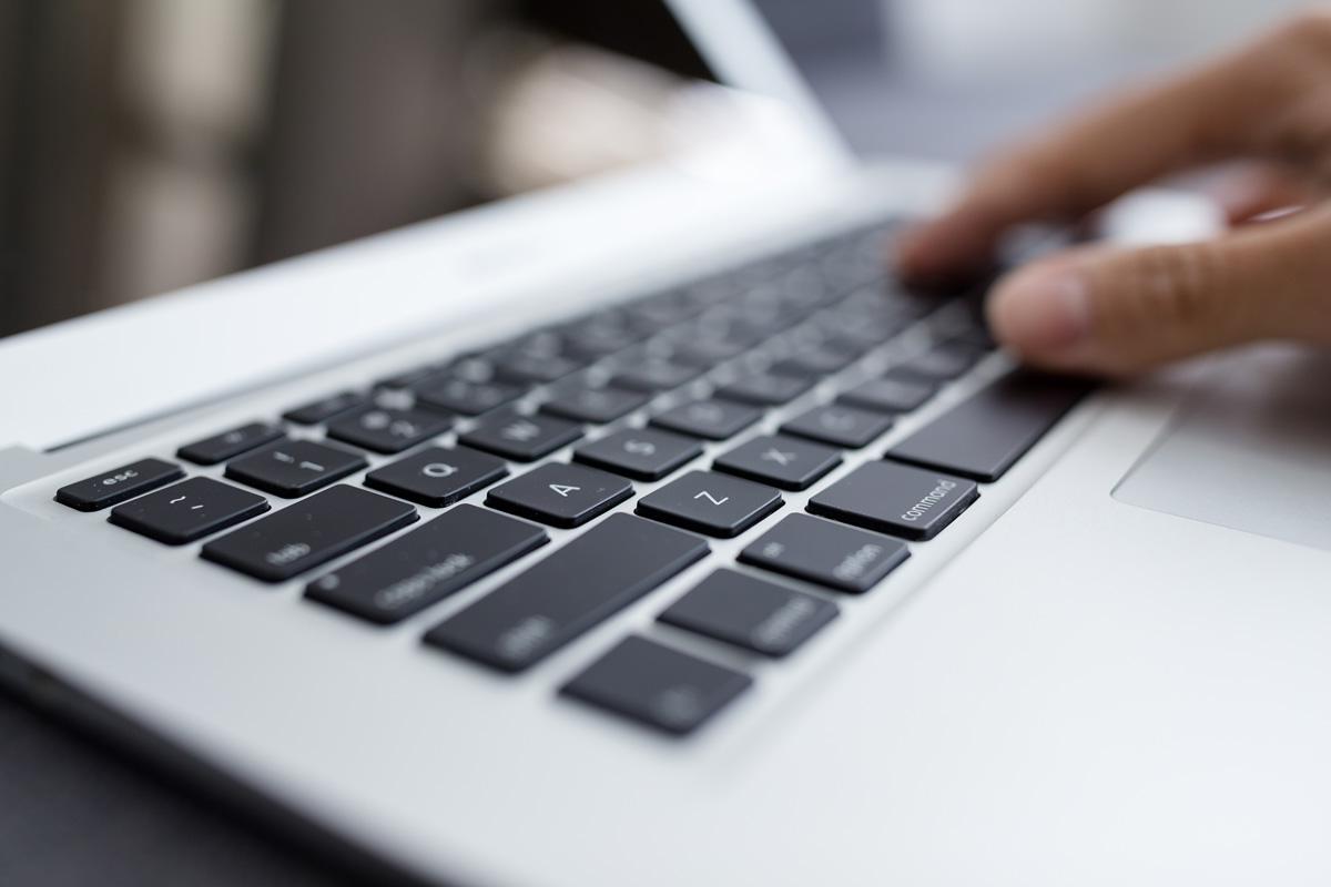 Man Typing On Laptop Computer H6ktzwe