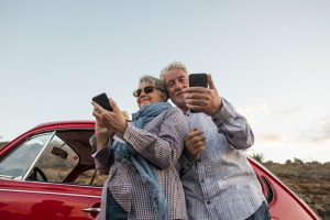 Elderly Couple On Mobile Devices