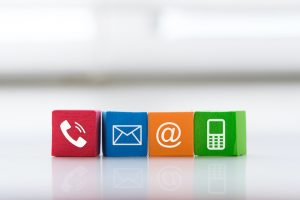 Contact Us Concept With Colorful Block Symbol Telephone, Mail, Address And Mobile Phone.